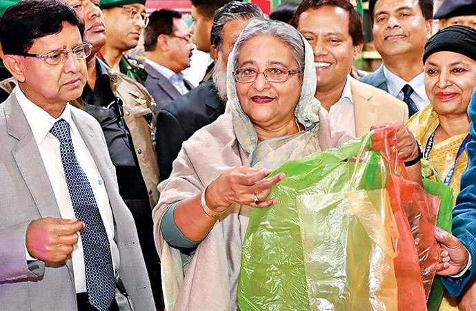PM Sheikh Hasina presenting a Sonali bag - The Story Watch